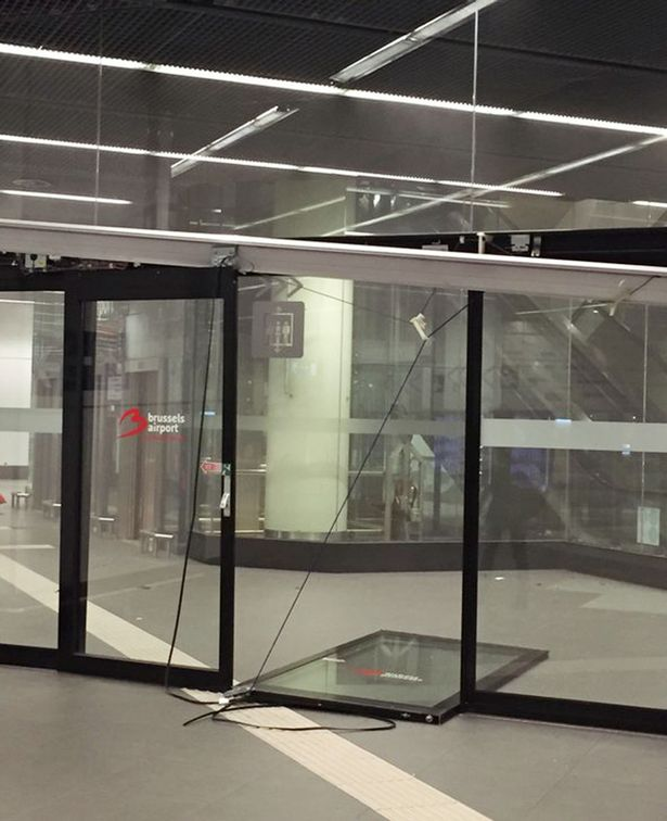 Door-blown-of-hinges-at-Brussels-Airport-train-station-following-an-explosion
